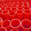 Large Group of Red Industrial Plastic Pipes Full Frame — Stock Photo #69382805
