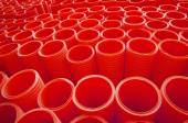 Large Group of Red Industrial Plastic Pipes Full Frame — Stock Photo