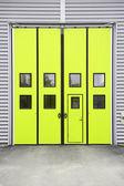 Yellow Garage Door on a warehouse building — Stockfoto