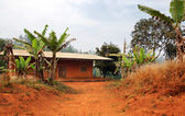Typical African red clay house — Stock Photo