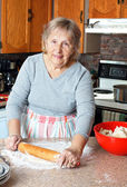 Grandma making pies — Stock Photo