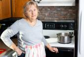Friendly grandmother cooking — Stock Photo