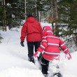 Woman and kid snowshoeing — Stock Photo #66312273