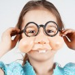 Little girl with fake nose glasses — Stock Photo #70920123