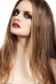 Beauty close-up portrait of beautiful young woman model with dark evening catwalk fashion eyes make-up — Stock Photo