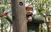 Boy climbing at playground — Stock Photo