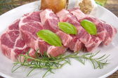 Neck with rosemary and basil — Stock Photo