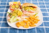 Italian Sub Sandwich with Pickles and Chips — Stock Photo
