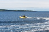 Yellow Pilot Boat Cutting Across Bay — Stock Photo