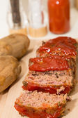 Sliced Meatloaf and Baked Potatoes on Wood Board — Stock Photo
