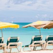 Sun Umbrellas Over Green Chairs on Beach — Stock Photo #54791245