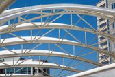 White Curved Tubular Steel Architecture Under Blue Sky — Stock Photo