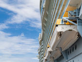 Lifeboats Under Balconies and Nce Sky — Stock Photo