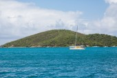 Catamaran in Blue Water by Green Hills — Stock Photo
