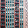 Red Iron Balconies on Old Brick Building — Stock Photo #60702685