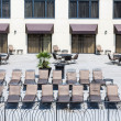 Chaise Lounges on Hotel Patio — Stock Photo #60819991