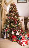 Wrapped Presents Under Decorated Christmas Tree — Stock Photo