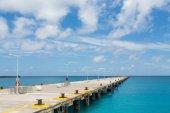 Concrete Pier into Blue Ocean — Stock Photo