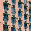 Many Flower Boxes on Brick Building Balconies — Stock Photo #64049589