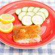 Baked Salmon with Lemon and Cucumber Slices — Stock Photo #64506561