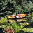 Glass Balls and Lilly Pads in Pond — Stock Photo #64899877