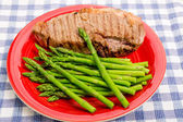 Asparagus on Red Plate with Steak — Stock Photo