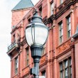 Classic Old Lamp Post by Brick Building — Stock Photo #67801179