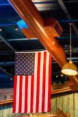American Flag Hanging from Rafters — Stock Photo