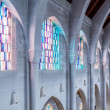 Stained Glass Between Stone Arches — Stock Photo #69302557