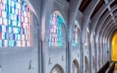 Stained Glass Between Stone Arches — Stock Photo