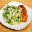 Baked Salmon with Ceasar Salad on Square Plate — Stock Photo #70984067