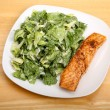 Caesar Salad with Salmon on square Plate — Stock Photo #71308899