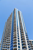 Concrete Balconies Up Blue and White Condo tower — Stock Photo