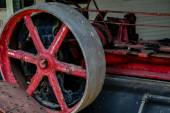 Old Red Wheel in Machinery — Stock Photo