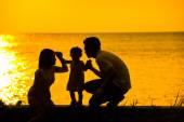 Asian family outdoor sunset beach — Stock Photo
