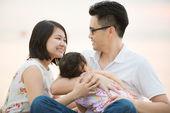 Happy Asian family at outdoor beach — Stock Photo