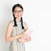 Asian Chinese school girl hands holding text books  — Stock Photo
