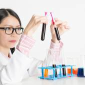 Asian lab worker doing blood test — Stock Photo