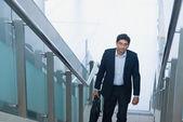 Asian Indian businessman ascending steps — Stock Photo