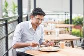 Indian businessman eating food — Stock Photo