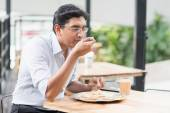 Indian business man eating food — Stock Photo