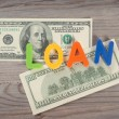 Bank notes and loan alphabet — Stock Photo #68349337