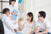 Asian couple consult doctor — Stock Photo
