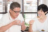 Asian Senior Couple Eating — Stock Photo