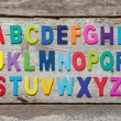 Colorful wooden English alphabet set — Stock Photo #73645567