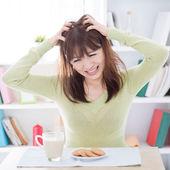 Asian girl feeling bored with her breakfast — Stock Photo