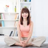 Woman doing yoga at home — Stock Photo
