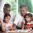 Multi generations family playing games — Stock Photo #79645910
