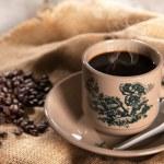 Traditional oriental Hainan coffee in vintage mug — Stock Photo #80597536