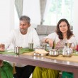Indian family dining in kitchen — Stock Photo #82194212